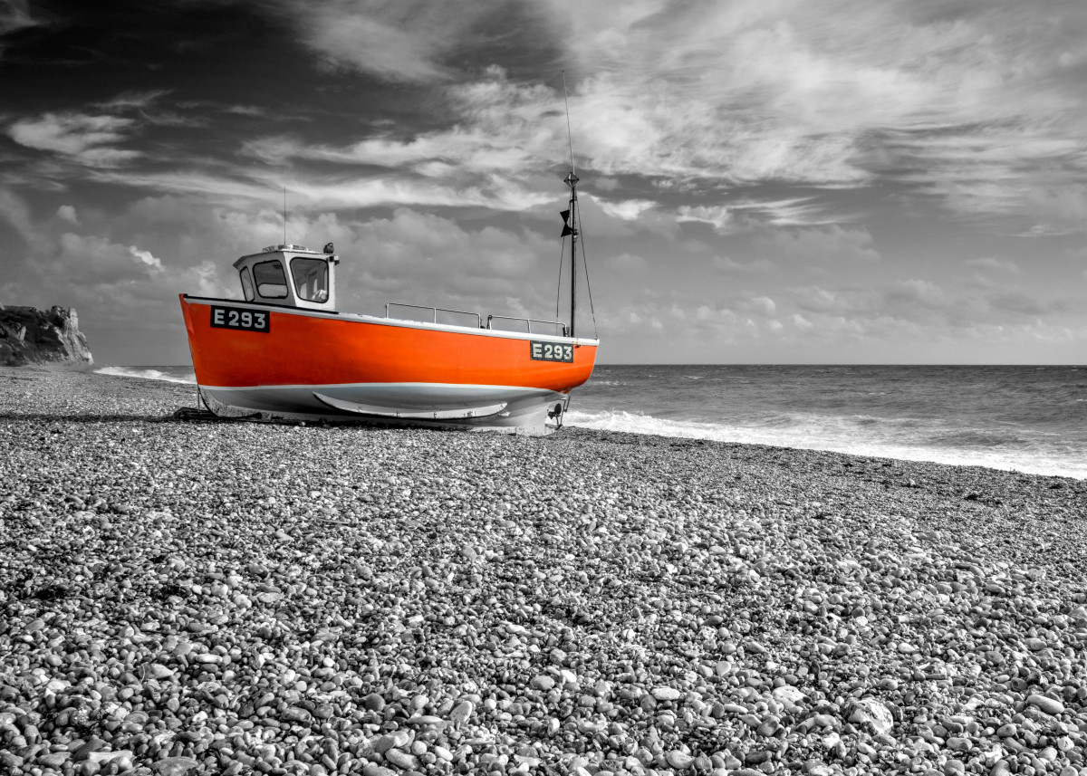 Orange Boat Selective coloured fishing boat on Branscombe beach, Devo