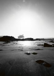 fuerteventura american star black white sand ship rocks water beach footprint tails wave vacance
