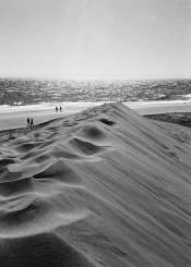 sand beach dune man walk sea water horizon evening sun sunset line sky cloud wave cloud photography