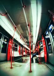 subway person empty tube underground travel work sad sadness alone doors train railway red blue fisheye wide light night milan late traveler passenger lone