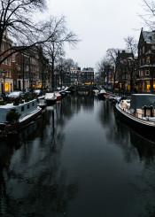 amsterdam city canal reflection evening dutch netherlands
