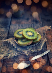 kiwi fruit sweet feed rustic wood dark nutrition light bokeh