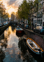 amsterdam sunset reflection skies dutch europe boats canal