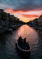 amsterdam sunset boat canal dutch europe