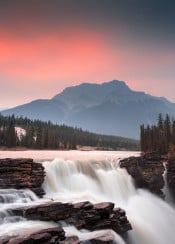 rockies sunrise sunset scenic jasper national park view canada waterfall mountains water flow river red warm epic cool