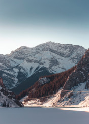mountain mountains rockies peaks snow winter lake frozen ice trees sunset sunrise light dawn dusk alberta canada west canmore