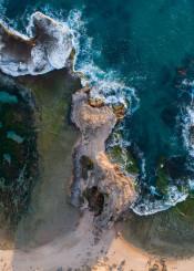 shore rock wave ocean water