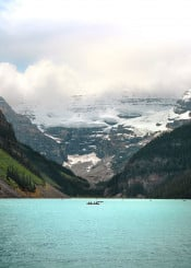 lake louise mountain blue rockies glacier view scenic epic alberta banff canada west nature landscape boats day clouds