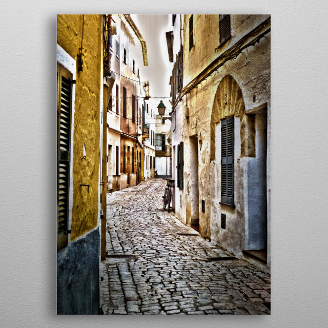 Ciutadella - Cobblestone street with bicycle in old part of Ciutadella, Spain. metal poster