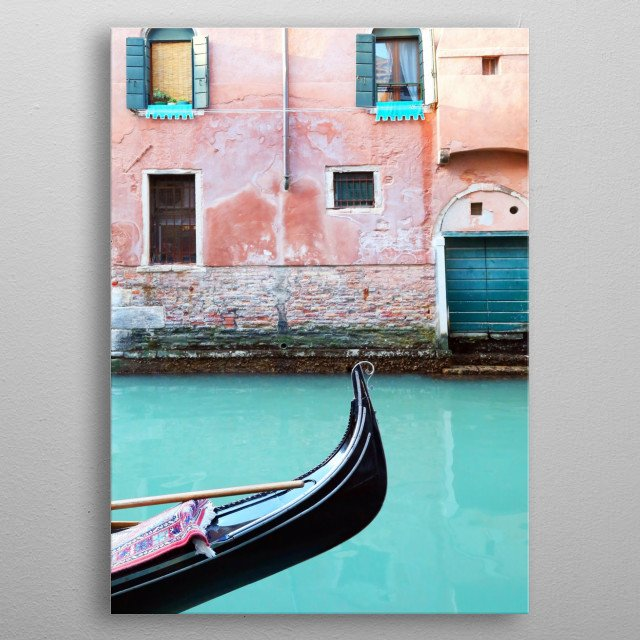 Venice photography with a gondola gliding down an aqua canal lined with coral, blush pink, and terra cotta buildings.  metal poster