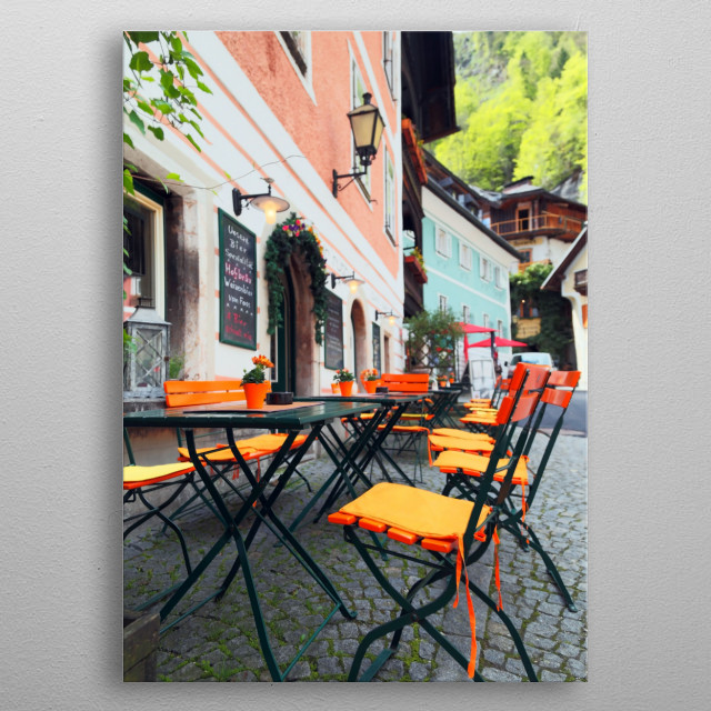 Bright orange chairs stand ready for diners at an outdoor cafe.  metal poster