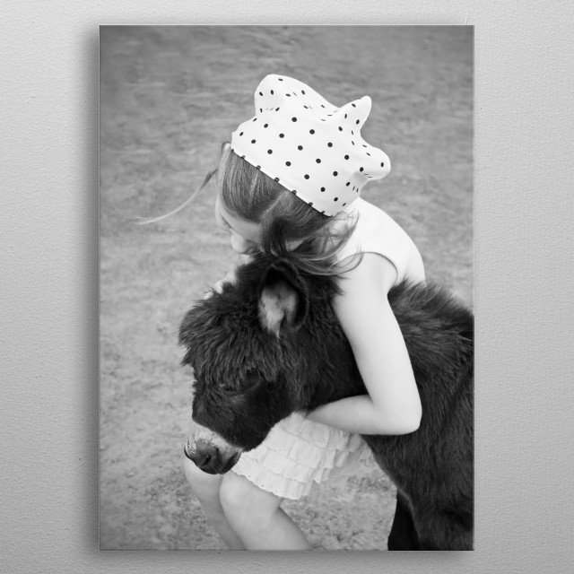 A little girl - my daughter - hugs a furry baby donkey. She has a retro look about her with her polka dot bandana and pleated dress. metal poster