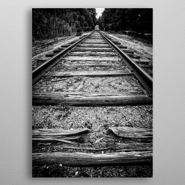 Old worn train tracks vanishing in the distance.   Fine art photography by Edward M. Fielding metal poster