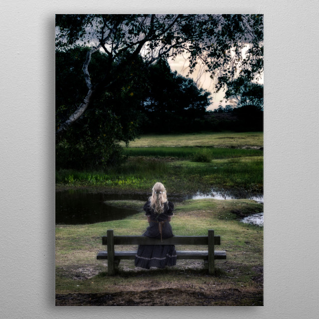 a blonde girl in a floral dressl is sitting on a bench at a pond metal poster