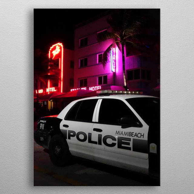 Miami Beach police car on Ocean Drive, with glamorous hotel. March 2015 metal poster