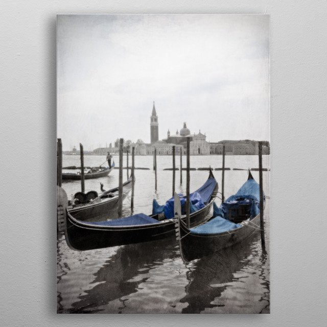 Black and white Venetian view of two blue gondolas with San Giorgio Maggiore in the background. A gondolier navigates his craft through the water. metal poster