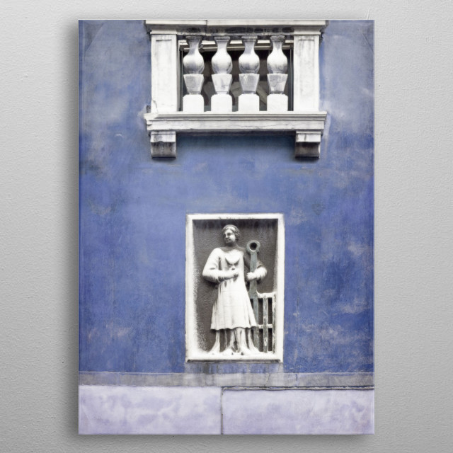 A carving below a balcony on a wall in Venice, Italy, finished in cobalt - indigo - royal blue.  metal poster