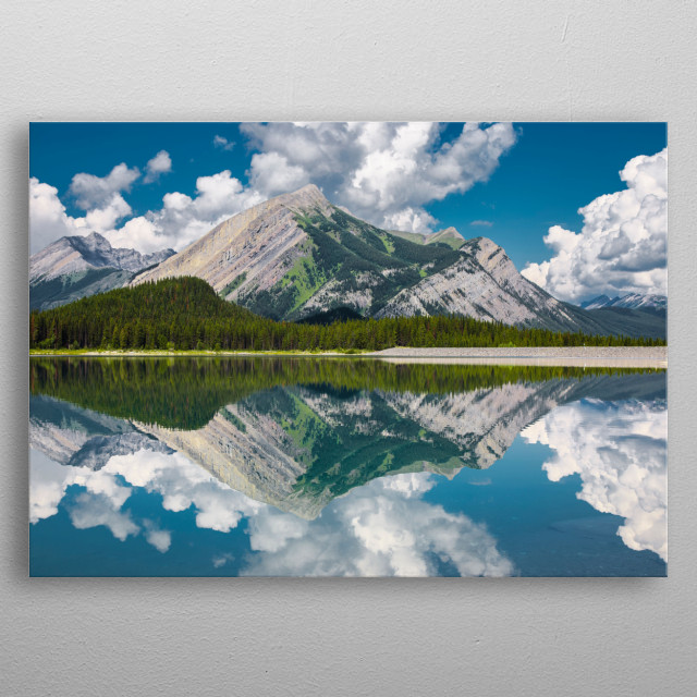 Mirroresque reflections of the distant mountains from Upper Lakes, Kananaskis metal poster
