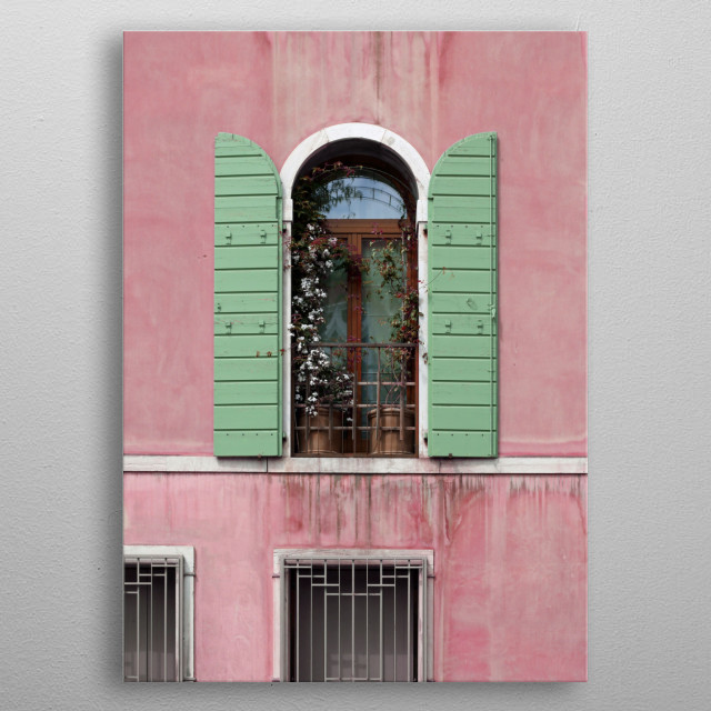 Pretty pink and mint green Venetian architecture is the focus of this fine art photo. Climbing vines and flowers grow from pots in the window... metal poster