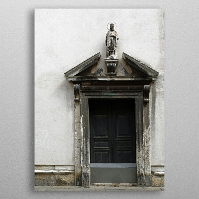 A religious statue sits atop an embellished doorway in Venice, Italy.  Photography by Brooke T Ryan. metal poster