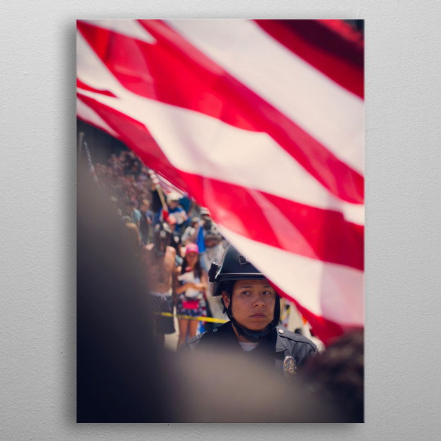 A police officer behind the American flag during a protest in Los Angeles metal poster