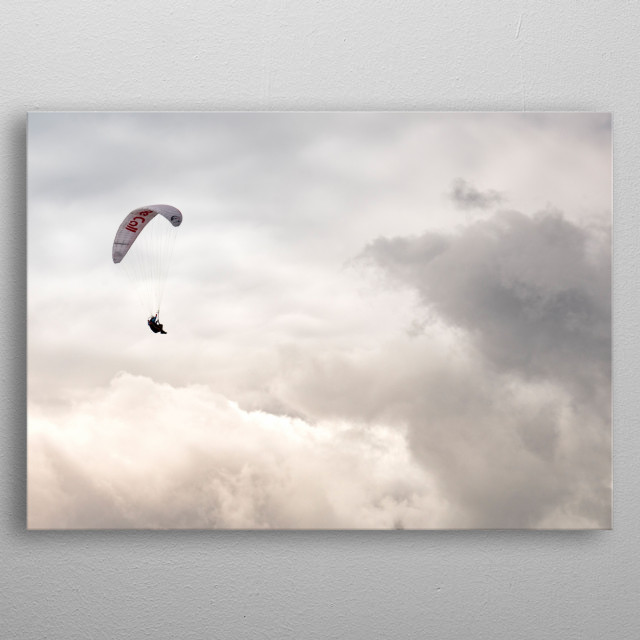 Paraglider in the clouds metal poster