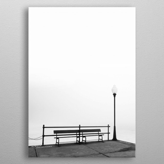 A warm, early Spring day in Central New York caused a thick mist to rise from the frozen lake. It was close to sunset. The abundance of soft white light and the fog draped over everything made for a surreal atmosphere. metal poster