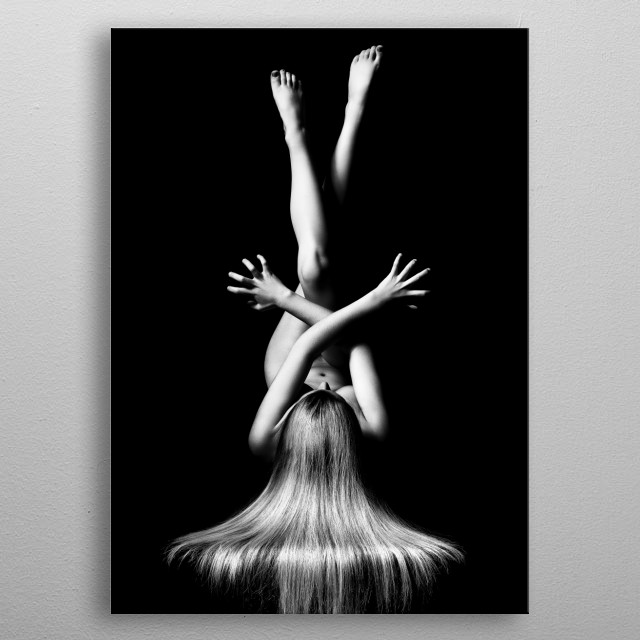 Bodyscape of a naked woman lying with legs and arms crossed against a black background. Photographed from above metal poster