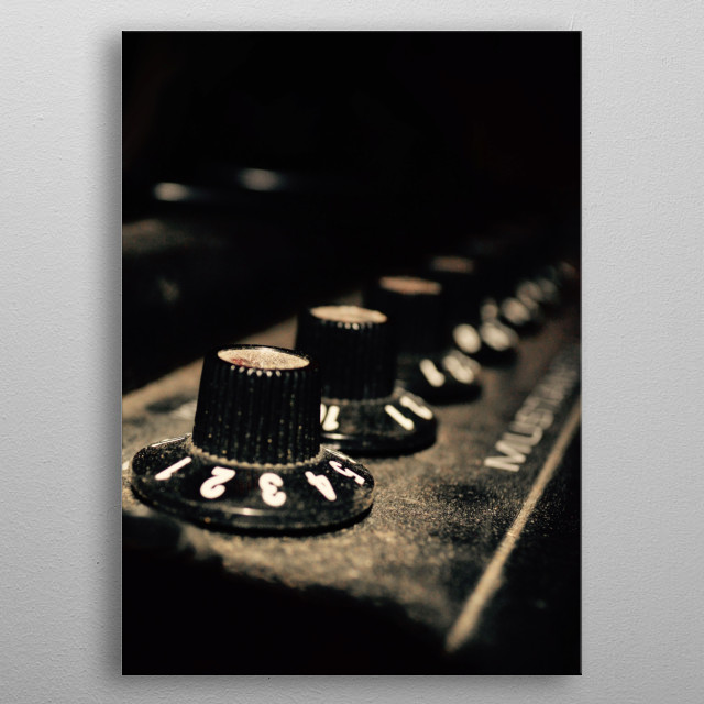 Photograph of a classic guitar amplifier. metal poster