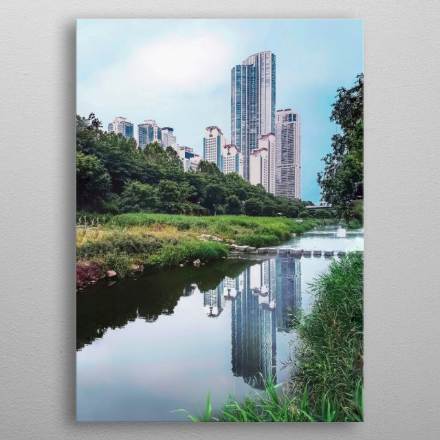 The skyscrapers of Gangnam in Seoul, South Korea; reflecting on a river passing by. metal poster