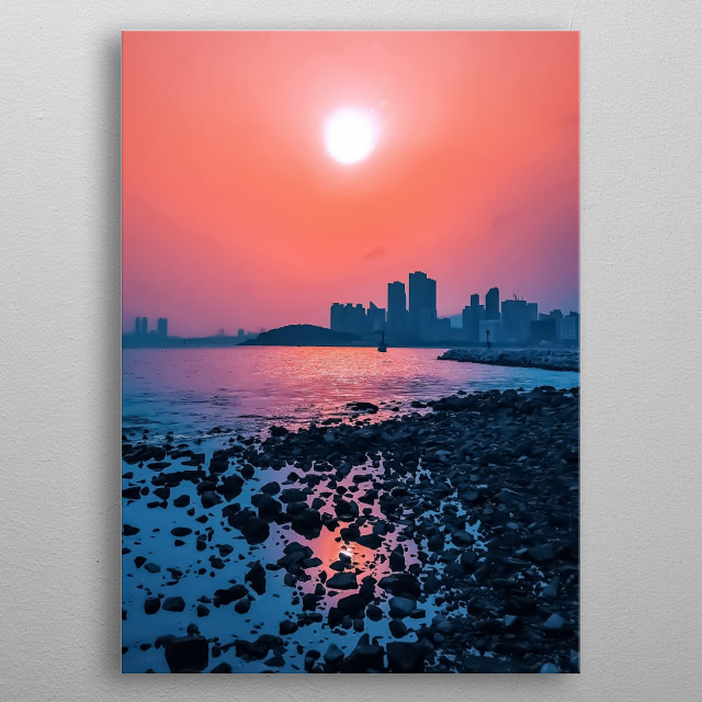 The beautiful Haeundae Beach in Busan, South Korea. The sunset makes the skyline look like a silhouette. metal poster