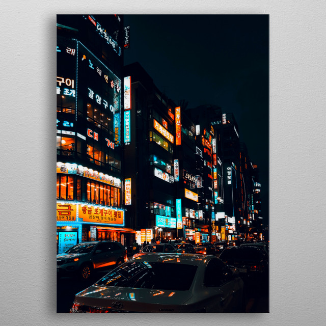 The busy streets of Busan, South Korea; near the Haeundae Beach. The street lights reflecting on the cars create and aesthetic look. metal poster