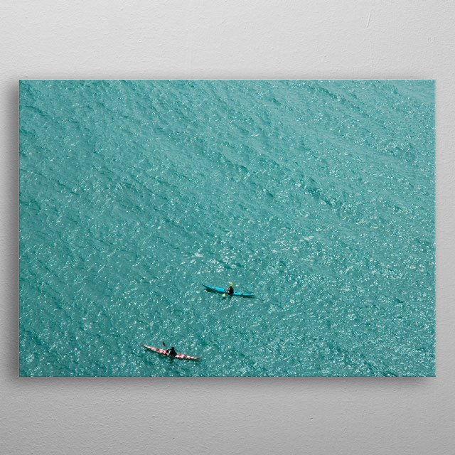 2 canoes or kayaks paddling the waters around South Stack near Holyhead on Anglesey, North Wales, UK  metal poster