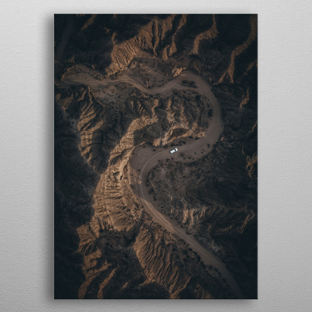 Driving through dry riverbed in the middle of Anza Borrego Desert in California / US.  metal poster