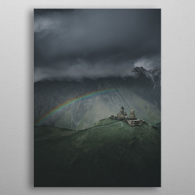 Very, very lucky shot. Most people don't believe this actually happened but it did. Rainbow over Gergeti Trinity Church in Georgia.  metal poster