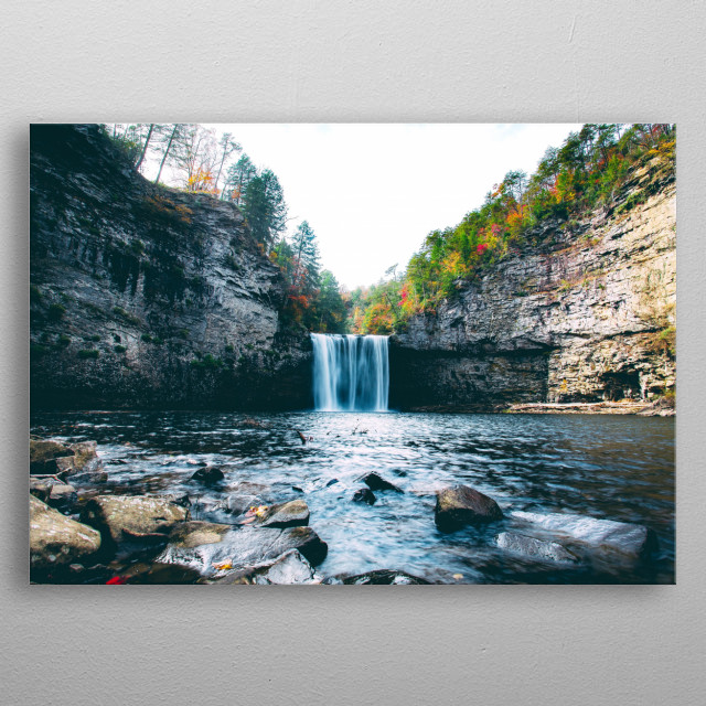 A waterfall pouring out of the forest into a clearing. metal poster