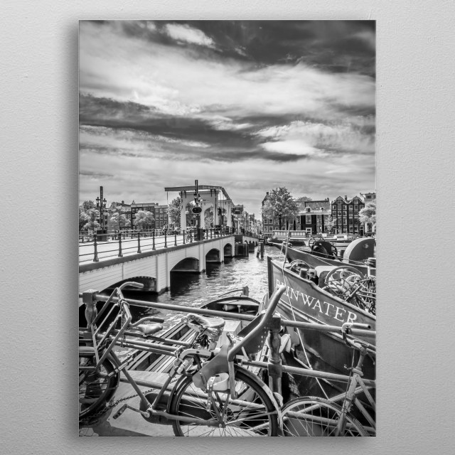 The Magere Brug is a bridge over the river Amstel in Amsterdam. Classical cityscape. metal poster