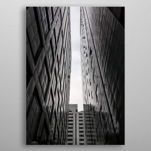 The picture was taken in Gangnam, South Korea. It is edited to be black and white however: the space between 2 skyscrapers was very dark.  metal poster