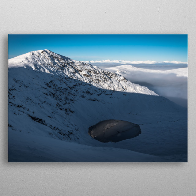 A spectacular cloud inversion left only the tallest mountains to bask in the sunlight. Taken from Stuchd an Lochain. metal poster