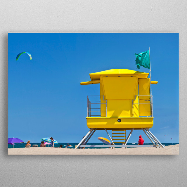 Photograph of a yellow Life Guard Tower at the beach of the Costa Brava Spain with people, kite surfer and blue sky. metal poster