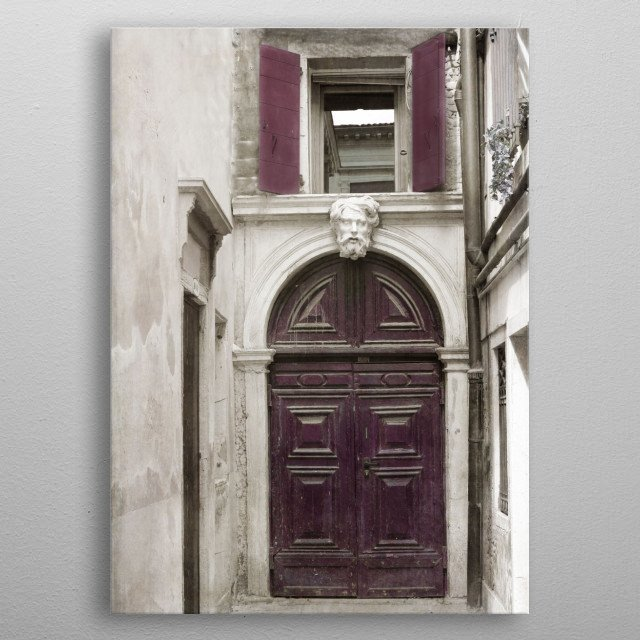 This deep plum door in Venice, Italy is topped by a sculpture of a man. Open shutters reveal a window above the sculpture.   metal poster