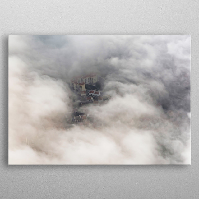 Aerial of city seen through clouds. metal poster