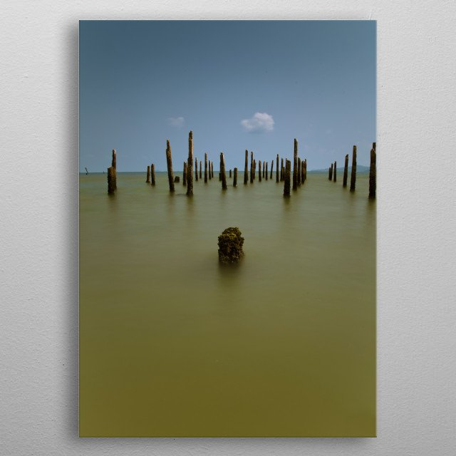 Vertical long exposure photography of vertical wood stick at sea with clear sky metal poster