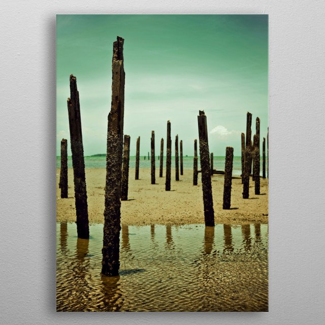 Photography of vertical wood stick in the sea at low tide and clear sky metal poster