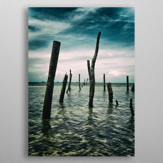 Photography of vertical wood stick in the sea metal poster