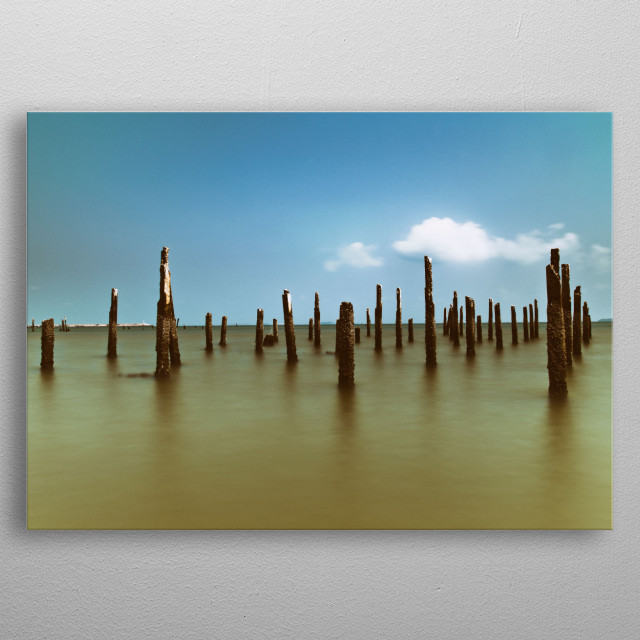 Horizontal long exposure photography of vertical wood stick at sea with clear sky metal poster