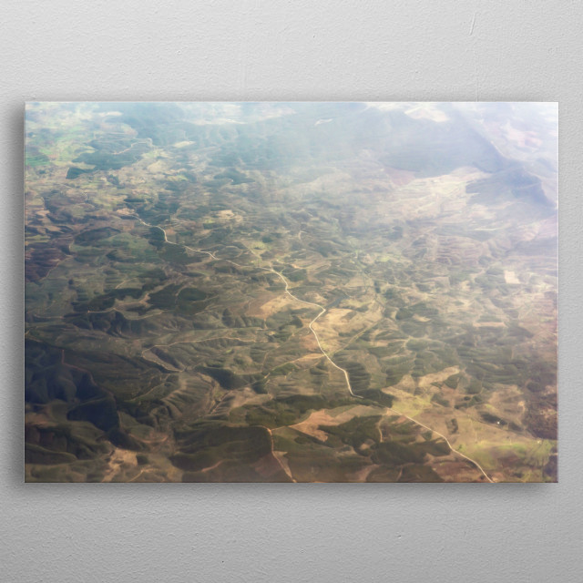 Aerial hazy landscape with mountains and vegetation. metal poster