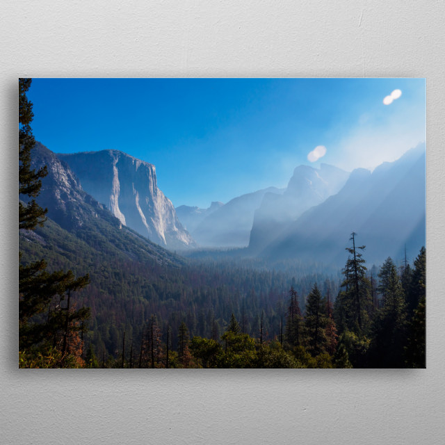 A view along Yosemite Valley in the morning, while it's still cloudy. El Capitan is on the left. metal poster