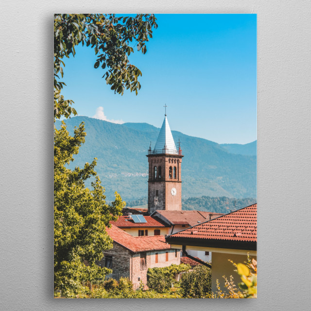 View on a little bell tower in a little village in Italian mountains metal poster