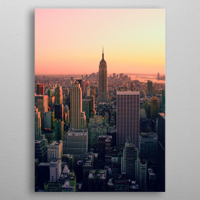 The sun setting on the Empire State Building in Manhattan, New York. metal poster